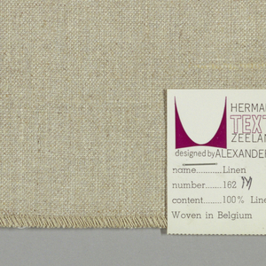 Plain weave in beige with silver coating on the reverse.
