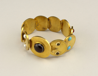 Gem-set gold disc bracelet.