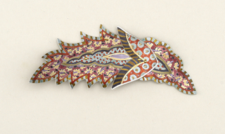 Leaf-shaped brooch in colorful pattern.
