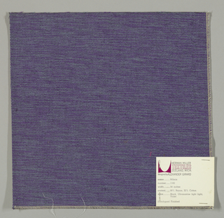 Weft-faced plain weave in violet, light blue and black. The violet and light blue weft threads give the predominant color. There are black warp threads which appear on the surface. A black binding warp is visible on the reverse.