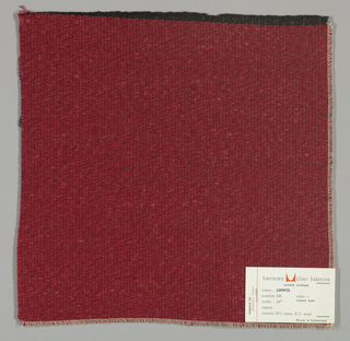 Weft-faced plain weave with doubled wefts in dark red and red. Warp threads are black. Number 246.