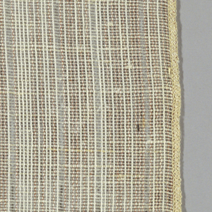 Gauze weave with tan and white warps and white wefts. Number 681.