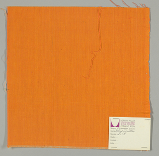 Plain-woven cotton in bright orange. Slight variations in the color of the warp threads give a subtle stripe effect.
