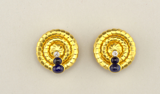 Pair of carbochon saphire, diamond and gold cuff buttons.