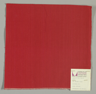 Plain-woven cotton in red. Slight variations in the color of the warp threads give a subtle stripe effect.