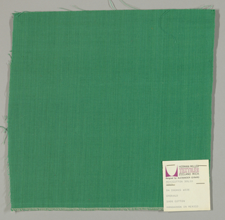 Plain-woven cotton in green. Slight variations in the color of the warp threads give a subtle stripe effect.