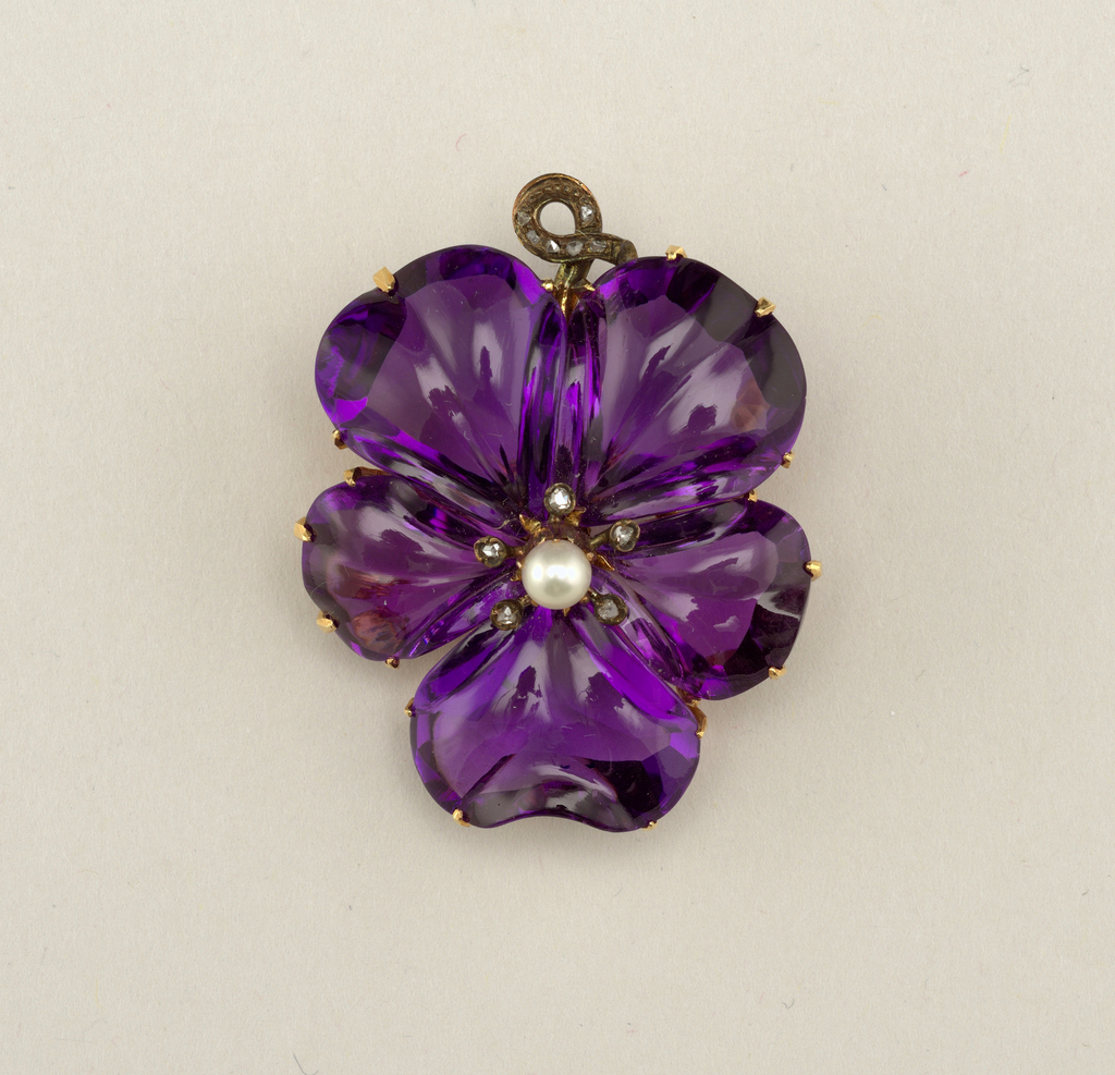 Carved amethyst and rose-cut diamond brooch.