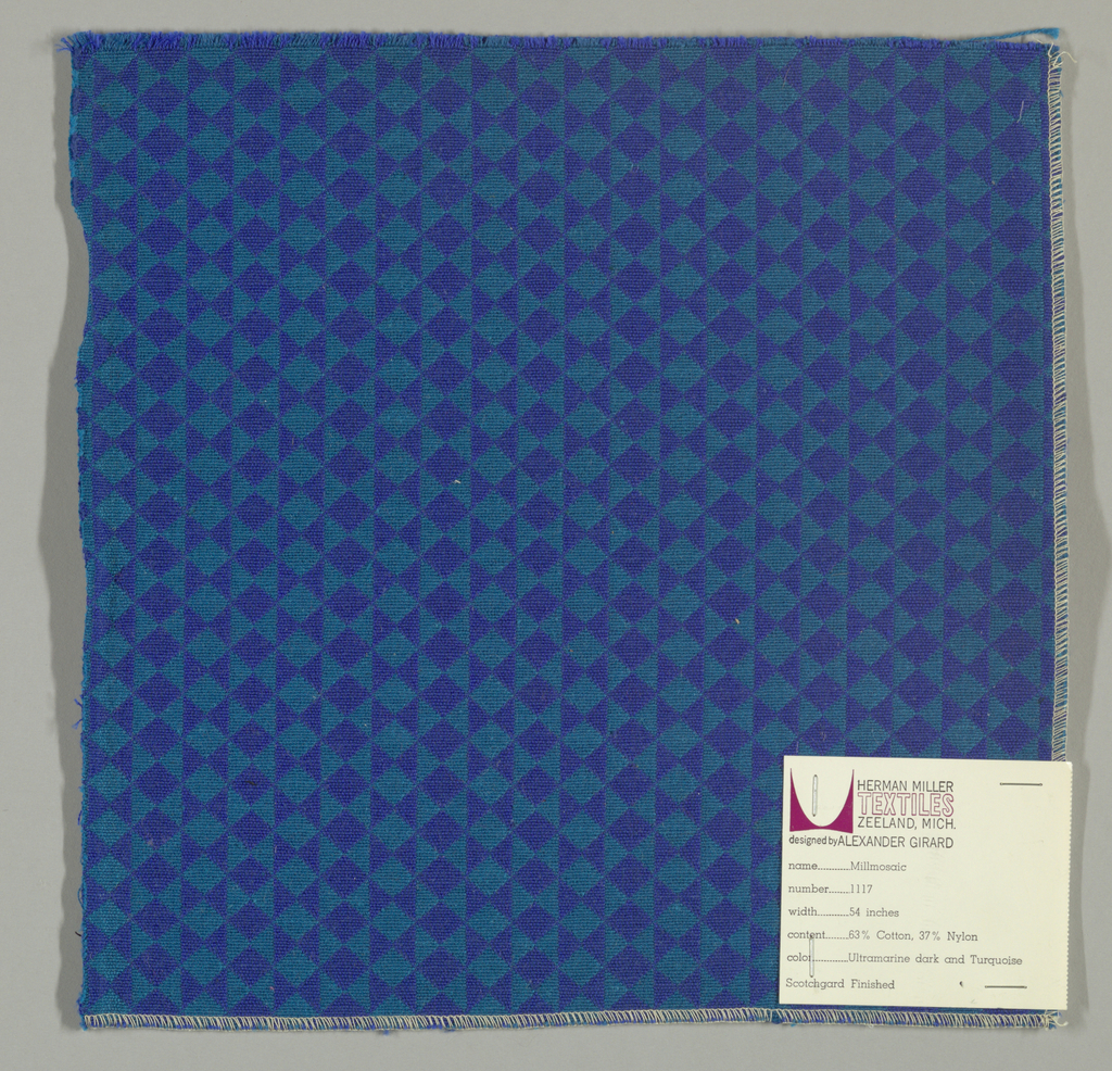 Double cloth in a blue and turquoise striped pattern of diamonds and triangles. The warps are blue and green and the wefts are turquoise and dark blue. The blue warp and dark blue weft intersects to give the appearance of a solid color. The green warp and turquoise weft intersect to give the appearance of a solid color.