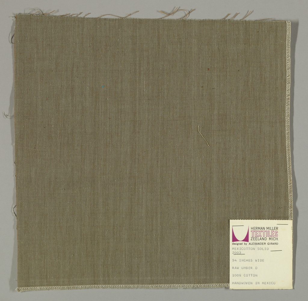 Plain-woven cotton in taupe. Warp threads are grey and the weft threads are brown. Slight variations in the color of the warp threads give a subtle stripe effect.