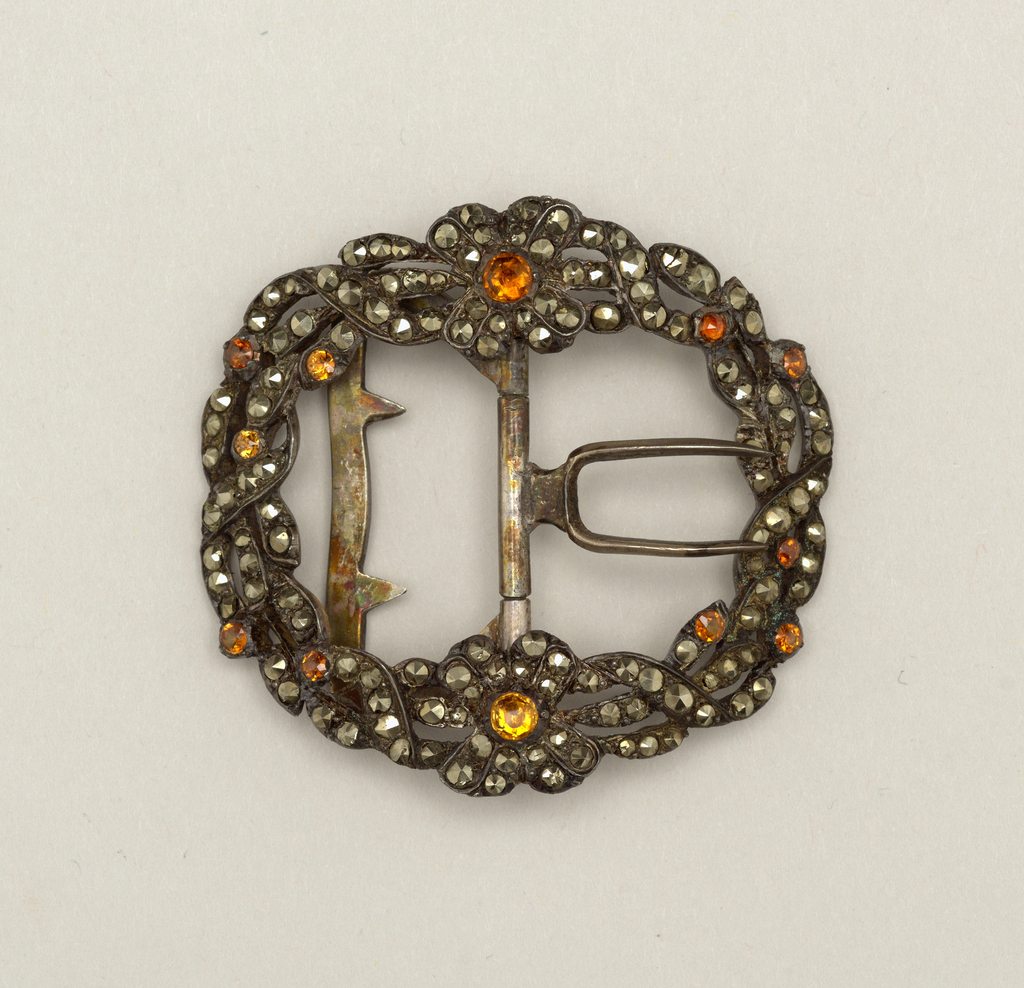 Buckle with frame in design of flowers and twisted lines in cut steel with yellow rose-cut pyrites; prings and fastener of steel.