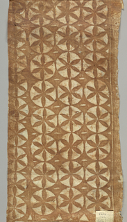 Tapa cloth printed in design of brown daisies on white circles on brown ground.
