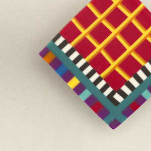 Square flat shapes. Brightly colored geometric pattern consisting of red and yellow grid, surrounded by frames of black and white, and of polychromesquares, all produced in colored-body marquetry technique. Metal posts and metal and plastic fasteners attached at back of each.