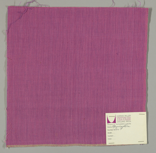 Plain-woven cotton in dark pink. Warp threads are pink and the weft threads are purple. Slight variations in the color of the warp threads give a subtle stripe effect.