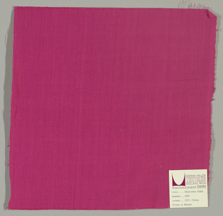Plain-woven cotton in magenta. Slight variations in the color of the warp threads gives a subtle stripe effect.