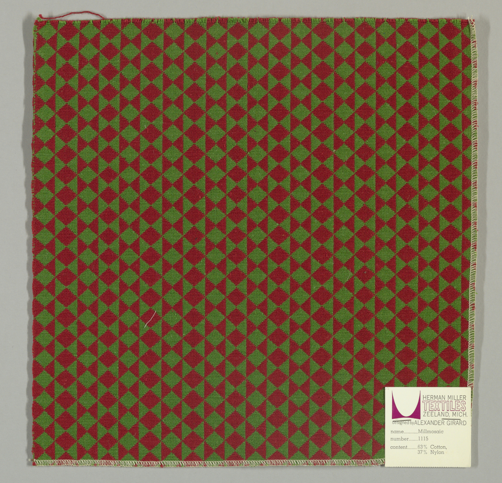 Double cloth in a green and red striped pattern of diamonds and triangles. Green and red warps and green and red wefts intersect to make solid areas of color in the design.