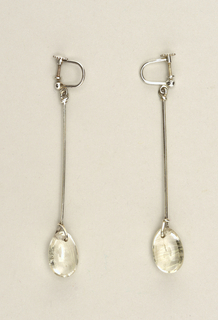 Earrings composed of silver sticks with oval quartz stone at end.