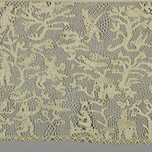 Flounce with a design of huntsmen, birds, animals, and elaborate tree pattern.