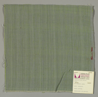 Plain-woven cotton in grey-green. Warp threads are grey and the weft threads are green. Slight variations in the color of the warp threads give a subtle stripe effect.