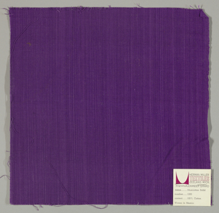 Plain-woven cotton in purple. Slight variation in the color of the warp threads gives a subtle stripe effect.