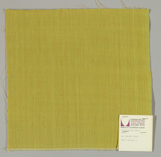 Plain-woven cotton in yellow-green. Warp threads are green and the weft threads are gold. Slight variations in the color of the warp threads give a subtle stripe effect.