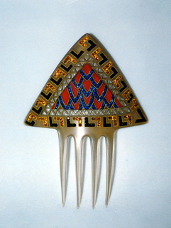 Translucent ornamental hair comb, the curved triangular head with openwork bands and painted geometric decoration in black, yellow, ochre, red and blue, picked out with tiny circular black, yellow, and blue faceted glass pastes; four long curved teeth.