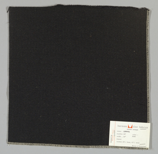 Weft-faced plain weave with doubled wefts in black. Warp threads are black. Number 247.