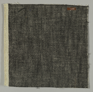 Plain weave with black warp and white weft. Heavy nylon yarns give a coarse surface texture.