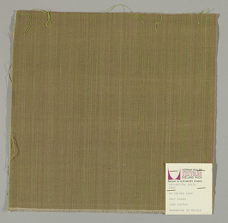 Plain-woven cotton in olive green. Warp threads are light brown and the weft threads are green. Slight variations in the color of the warp threads give a subtle stripe effect.