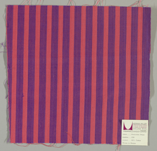 Plain weave with vertical stripes of violet and bright pink.