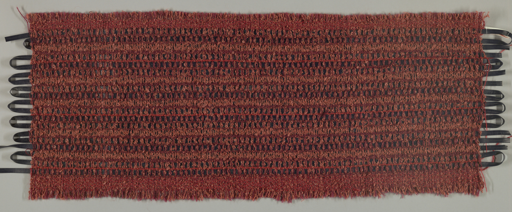 Plain weave in various shades of pink and red boucle mohair yarn with navy leather strip in the weft.