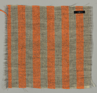 Plain weave of variegated grey and orange vertical stripes. The grey striped areas are comprised off-white warps while the wefts are comprised of white threads loosely twisted with black goat hair. The orange stripes are made of heavier warp threads with a slight sheen.