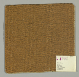 Weft-faced plain weave in light brown with a plain weave foundation. Weft-facing yarns are coarse and loosely twisted. Foundation weave consists of brown warp threads and dark brown weft threads.