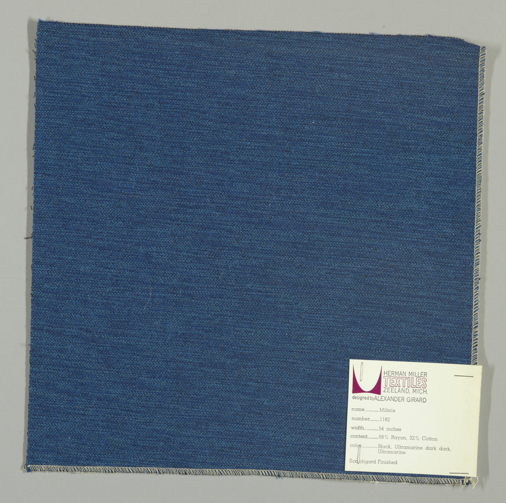 Weft-faced plain weave in blue, light blue and black. The blue and light blue weft threads give the predominant color. There are black warp threads which appear on the surface. A black binding warp is visible on the reverse.