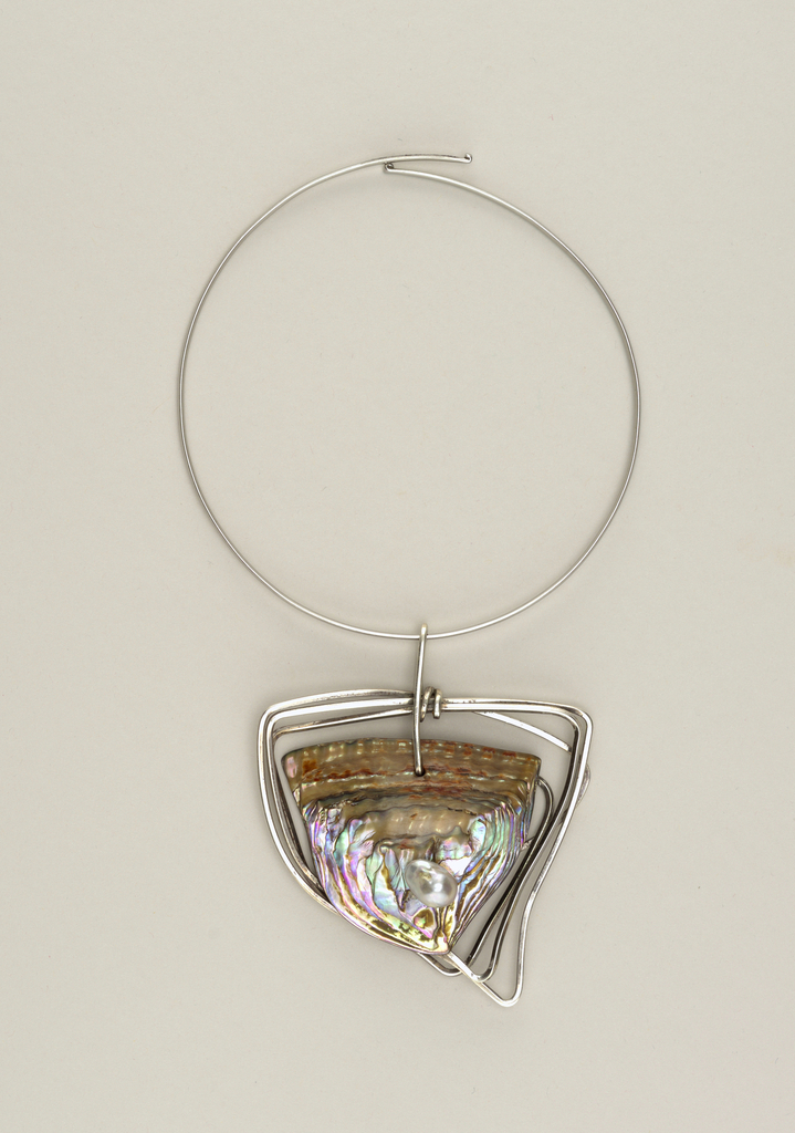 Neckring of a silver circular loop suspending triangular mother-of-pearl pendant, outlined by a triple border of silver wire