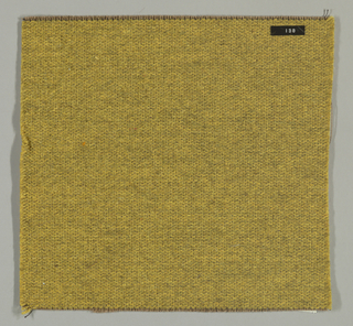 Weft-faced plain weave in dark yellow with a plain weave foundation. Weft-facing yarns are coarse and loosely twisted. Foundation weave consists of brown warp threads and dark brown weft threads.