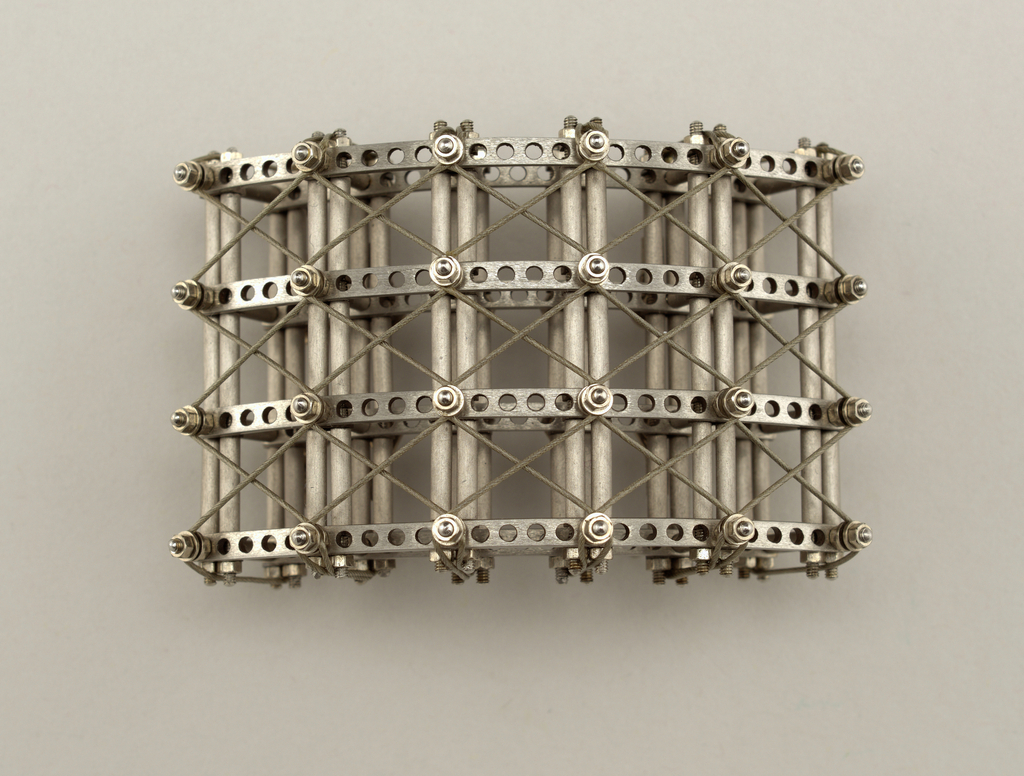An arching rectangle brooch with and architectural composition.