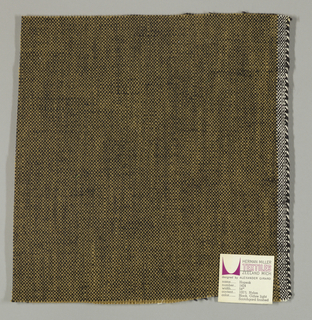 Plain weave with tan warp and black weft. Heavy nylon yarns give a coarse surface texture.