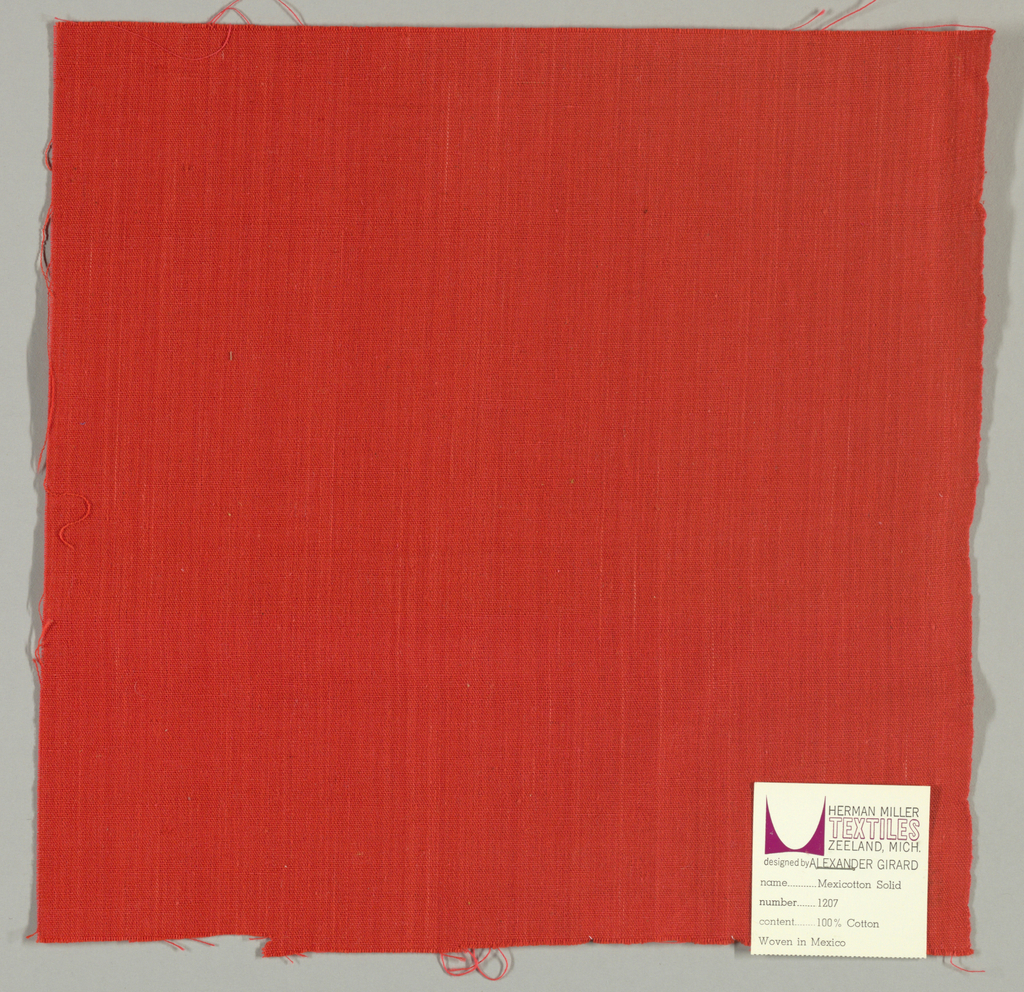 Plain-woven cotton in red. Slight variation in the color of the warp threads gives a subtle stripe effect.
