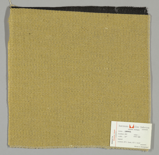 Weft-faced plain weave with doubled wefts in pale yellow and dark yellow. Warp threads are black. Number 243.