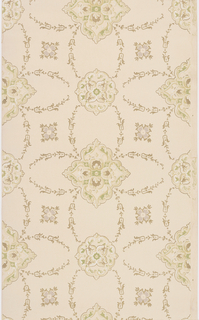Alternating large and small quatrefoil medallions contain foliate scrollwork and pearl details. Four floral swags radiate out from each medallion and link them together creating a pattern of cells. Smaller quatrefoil blossoms are placed in every other swag-outlined cell. Pattern is printed in pale green, pink, light beige and metallic gold on tan ground.
