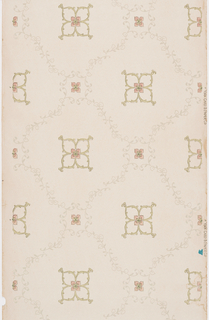 Diaper pattern of large and small diamond shapes created by delicate vines. Large and small quatrefoil blossoms are contained within each diamond-shaped frame. Outlines of blossoms are rendered in tiny dots. Blossoms printed in beige, tan pink and green, vines printed in pale gray on tan ground.