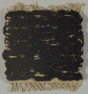 Alternation of braided wefts and thick wool wefts create texture. Reversible rug.
