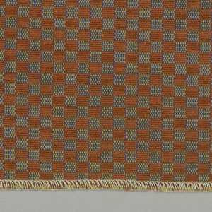 Double cloth in a small-patterned dark orange and blue checkerboard. Warp threads are light brown and gold. The weft threads are bright blue and orange.