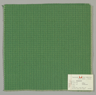 Textured plain weave in green. Warp is comprised of heavy yarns and shiny threads in green. Weft is comprised of thick and thin yarns in green.