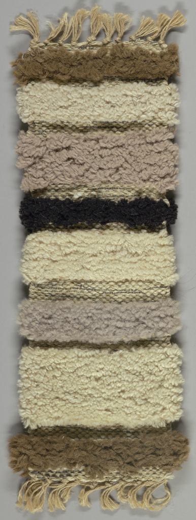 Hand woven in bands of beige, grey, back and white.