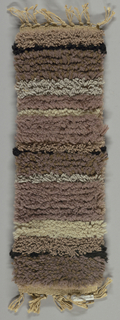 Bands of mauve, grey, tan and white pile. Reversible.