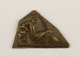 Polygon with straight lower edge. Repoussé figure of a reclining woman facing right.
