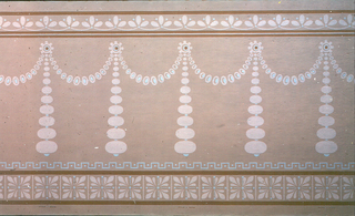 Wallpaper roll. Pink beaded swags with large beaded pendents. Stylized floral band running along top edge, with band of acanthus bosses running along bottom edge. Printed on pink ground.