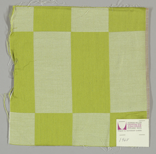 Damask with geometric patterning in yellow-green and white.