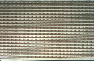 Wallpaper roll. Multiple bead-and-reel borders printed across width. Printed in shades of brown on tan ground.